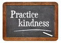 Practice kindness on blackboard inspirational advice a vintage slate Stock Image