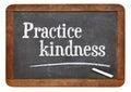 Practice kindness on blackboard inspirational advice a vintage slate Stock Image