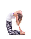 Practicing yoga exercises camel pose ustrasana young woman doing in studio on white background name Royalty Free Stock Photo