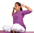 Practicing yoga indian teen girl doing pose on white background Stock Images