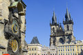 Prague astronomical clock with church towers on the background Royalty Free Stock Photography