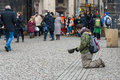 Prague beggar on charles bridge czech republic february the is a famous historic that crosses the vltava Stock Images