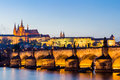 The prague castle built in gothic style and charles bridge are the symbols of czech capital built in medieval times twilight v Royalty Free Stock Photos