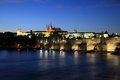 Prague castle and charles bridge at night Stock Photography