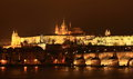 Prague castle and charles bridge with st vithus cathedral in front of it at night czech republic Royalty Free Stock Image