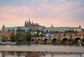 Prague castle and charles bridge at sunset Stock Photography