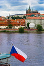 Prague castle with czech flag Stock Photography