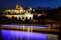 Prague castle in Hradcany with Vlatava river and lights from boats Royalty Free Stock Photo