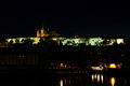 Prague castle in the night reflected on watter Stock Images