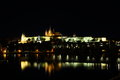 Prague castle in the night reflected on watter Royalty Free Stock Photo