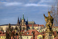 Prague castle and stone statue on Charles bridge, Czech republic Royalty Free Stock Photo