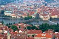 Prague charles bridge cityscape above the roofs of old central european metropolis modern tourist magnet and capital of the czech Royalty Free Stock Images