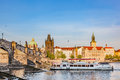 Prague, Czech Republic. Charles Bridge, boat cruise on Vltava river Royalty Free Stock Photo