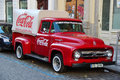 Prague czech republic oct an old renovated red ford vintage coca cola truck in a parking lot pickup on Royalty Free Stock Photo