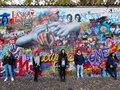 Prague, Czech Republic - October 31, 2018 Tourists pose in front of the John Lennon wall Royalty Free Stock Photo