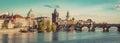 Prague, Czech Republic panorama with historic Charles Bridge and Vltava river. Vintage Royalty Free Stock Photo