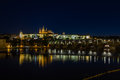 Prague palace and st vitus cathedral at night presidential of czech republic in city famous charles bridge watched by couple Stock Image