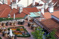 Prague roofs roof restaurant summer cafe eating take a cup of coffee on the roof of the building trips to Stock Photography