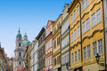Prague street with colorful houses and church Royalty Free Stock Photo