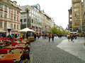 Prague street full of people and tourists