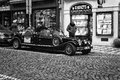 Prague tour of the city on an old car czech republic february black and white stylized film is capital and largest Royalty Free Stock Photography