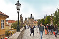 Prague tourists on the charles bridge cross linking over moldau river castle with old town construction begun Stock Image