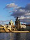 Prague towers and charles bridge in morning golden light Stock Images