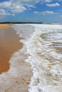 Praia da rocha algarve portugal seafoam waves along the golden sandy shored beach of in Royalty Free Stock Image