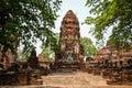 Prang and statue of Buddha, Wat Mahathat temple, Ayutthaya, Chao Phraya Basin, Central Thailand, Thailand Royalty Free Stock Photo