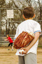 Prank with baseball and egg young pitcher swaps his for an to an unsuspecting batter Stock Images