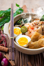 Prawn noodles mee famous malaysian food spicy fresh cooked har mee in clay pot with hot steam Royalty Free Stock Photos