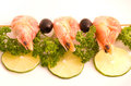 Prawn Skewer with lime and olives Royalty Free Stock Image