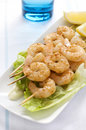 Prawn Skewers with Lemon wedges Stock Images