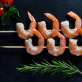 Prawn skewers with thyme and Tomatoes Royalty Free Stock Photo