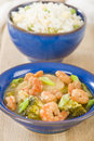 Prawns with ginger and spring onion chinese dish of broccoli water chestnuts sauce served Stock Photography