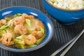 Prawns with ginger and spring onion chinese dish of broccoli water chestnuts sauce served Royalty Free Stock Image