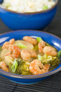 Prawns with ginger and spring onion chinese dish of broccoli water chestnuts sauce served Stock Photo