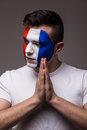 Pray France football fan in game  of France national  team look at side. Royalty Free Stock Photo