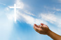 Pray for God`s blessing Cross on natural background. Royalty Free Stock Photo