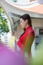 Pray moment profile view of a young woman praying in the temple Royalty Free Stock Images