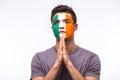 Pray for republic of ireland irishman football fan pray for game republic of ireland national team on white background european Royalty Free Stock Images