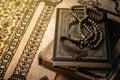 Prayer beads on Koran holy book of Muslims Royalty Free Stock Photo