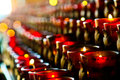 Prayer candles lit on red candle stands in a chapel Stock Photography