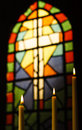 Prayer Candles And Stained Glass Church Window Royalty Free Stock Photo