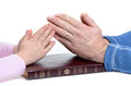 Prayer father and daughter hands in over bible white background Stock Photos