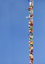 Prayer flags of different colors on blue sky Royalty Free Stock Photo
