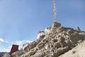 Prayer flags extending to a hillock near Tsemo monastery Royalty Free Stock Photo