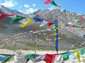 Prayer flags in the himalayas india tibetan and symbols at a road side Stock Photos