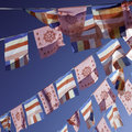 Prayer flags outside a buddhist temple Stock Images