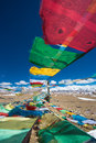 Prayer flags and the range of himalaya mountains in in the backg background on friendship highway tibet Royalty Free Stock Photos